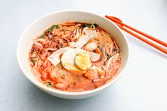 Penang popular prawn mee noodles with eggs, and small shrimp. Served on table stock image