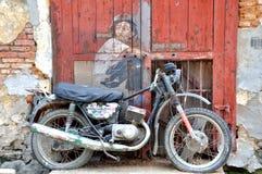 """Penang Street Art """"Boy on a Bike"""" royalty free stock photo"""