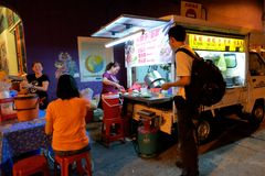 Penang street food. Penang street vendor selling chinese cooked food at night market in Georgetown Malaysia royalty free stock photography