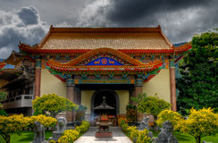 Penang - Temple of Supreme Bliss (Kek Lok Si). This is another smaller temple at the highest point of the Kek Lok Si grounds. The smoke emitting from the urn Royalty Free Stock Image