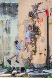 Penang wall artwork named Children Playing Basketball Royalty Free Stock Photo