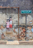 Penang wall artwork named Children on the Swing Stock Images