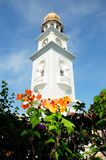 Penang - The White Clock tower. The whie clock tower with flowers Stock Photo