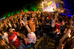 Penang World Music Festival. Crowds having fun dancing in front of the stage during the musical performance Stock Photo