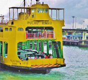 Penang 0012. Yellow ferry  in the current fleet is named after island pulau rimau in malaysia, it is mixed passenger (upper deck) and vehicle (lower deck Stock Image