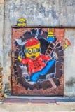 Penangmuurschildering met Minions Stock Foto's