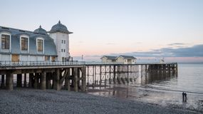Penarth Pier sunset dusk by the coasts of Wales. Penarth Pier during sunset by the coasts of Wales royalty free stock photo