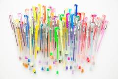 Penas brilhantes, coloridas no branco Imagens de Stock Royalty Free