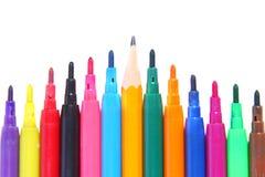 Penas coloridas com um lápis destacado Fotos de Stock