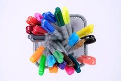 Penas coloridas em uma cesta Imagens de Stock Royalty Free