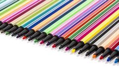 Penas coloridos de feltro Imagens de Stock