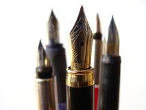 Penas da escrita da fonte Foto de Stock