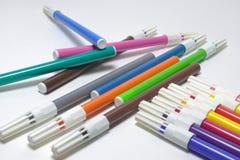 Penas de feltro em tampões ventilados protetores multicolored foto de stock royalty free