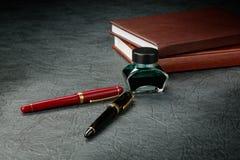 Penas de fonte com tinta Imagem de Stock Royalty Free