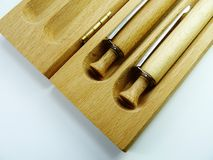 Penas de madeira no fundo de madeira Fotografia de Stock
