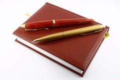 Penas e diário. Fotografia de Stock Royalty Free