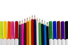Penas e lápis coloridos Foto de Stock Royalty Free