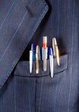 Penas em um bolso Fotografia de Stock Royalty Free