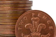 2 pence. A 2 pence coin in front of a pile of coins Royalty Free Stock Photography