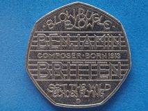 50 pence money GBP. Currency of United Kingdom, commemorative coin showing composer Benjamin Britten music royalty free stock photography