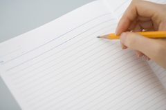 Pencil. Close-up shot of a pencil writing on the notebook Royalty Free Stock Photo