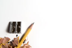 Pencil. With knife-sharpener on white Royalty Free Stock Image