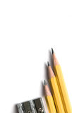 Pencil. S with knife-sharpener on white Stock Image
