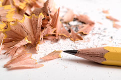 Pencil. With sawdust on white Royalty Free Stock Photo