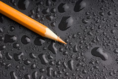 Pencil. Yellow pencil on black background Royalty Free Stock Photos