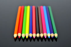 Pencil. Colored pencil on black background Stock Photos
