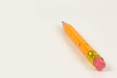 Pencil. Yellow Pencil on awhithe background Royalty Free Stock Image