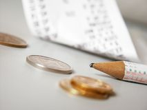 Pencil. Focused pencil, blured coinage in front and bill in background Royalty Free Stock Images
