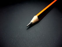 Pencil. On a black plane Stock Image