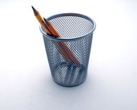 Pencil 2. Three sharp yellow pencil inside a silver basket Royalty Free Stock Image