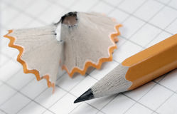 Pencil. Open notebook and pencil, focus on the pencil royalty free stock photo