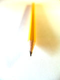 Pencil. Yellow pencil on white background Royalty Free Stock Images