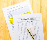Pencil on answer sheet and question sheet Stock Photos