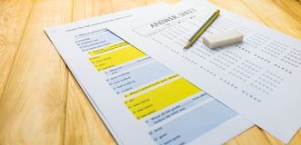 Pencil on answer sheet and question sheet Royalty Free Stock Image