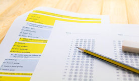Pencil on answer sheet and question sheet Royalty Free Stock Photo