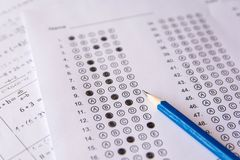 Pencil on answer sheets or Standardized test form with answers b. Ubbled. multiple choice answer sheet stock images