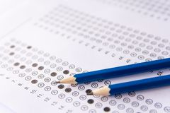 Pencil on answer sheets or Standardized test form with answers b. Ubbled. multiple choice answer sheet royalty free stock photo