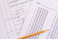 Pencil on answer sheets or Standardized test form with answers b. Ubbled. multiple choice answer sheet royalty free stock image