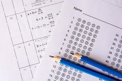Pencil on answer sheets or Standardized test form with answers b. Ubbled. multiple choice answer sheet stock photo