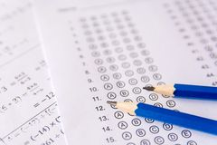Pencil on answer sheets or Standardized test form with answers b. Ubbled. multiple choice answer sheet stock photography