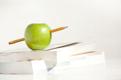 A Pencil through an Apple stock images