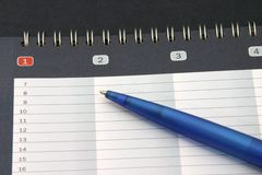 Pencil on appointment book Stock Image