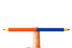 Pencil art balance. Pencil - art of balance, a pencil on finger showing opposite direction Royalty Free Stock Image