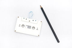 A pencil and an audio cassette tape Stock Image