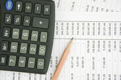 Pencil and black calculator on finance account Stock Image