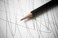 Pencil with black curved lines. Stock Photos